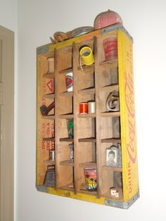 Yellow Coke crate display shelf Aw - the memories finding small stuff to display in our coke crate shelves...