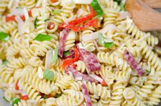 This super easy pasta salad combines all the elements of a delicious antipasto platter - salumi, cheese, olives - in a no-fuss dish that only gets better with time.