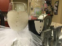 Hand painted bride and groom glasses.