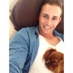My gorgeous man and our napping King Charles cavalier.
