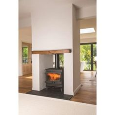 Double side woodburning stove. #openplan #openplanfire #wood #multifuel