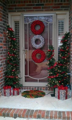 Exterior, Lovely Front Porch Christmas Decorations: Wonderful Red And White Wreath On The Glass Front Door And Three Christmas Tree On The P...