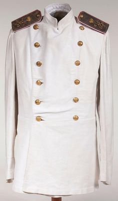 Imperial Russian officer's summer tunic, circa 1900.  White cotton double breasted tunic as adopted in 1888 with brass double headed eagle buttons. Has General's shoulder boards of the Imperial Suite, silver bullion with red and white piping, and a gold crowned Nicholas II cipher.