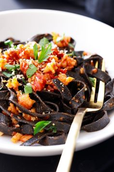 Spicy Squid Ink Fettuccine with Shrimp and Chorizo made with homemade squid ink pasta tossed with a spicy tomato sauce made with Spanish-style chorizo and fresh shrimp. Top with fresh parsley and toasted garlic breadcrumbs to complete the dish! Chorizo Recipes, Vegetarian Pasta Recipes, Yummy Pasta Recipes, Healthy Recipes On A Budget, Noodle Recipes, Fish Recipes, Chorizo Pasta, Sausage Pasta, Kitchens