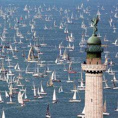 """The """"Faro della Vittoria"""" lighthouse during the Barcolana competition, Trieste in northern Italy."""