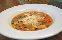 Chicken Enchilada Soup in the Slow Cooker Recipe Soups with chicken fingers, red bell pepper, onion, black beans, tomatoes, cream style corn, frozen corn, cream of chicken soup, enchilada sauce, milk