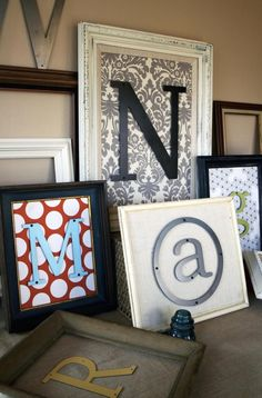 medium vintage frame, backed with fabric or wallpaper, with metal or wood letter