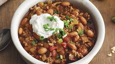 Top this stick-to-your-ribs chili with tortilla chips, shredded Cheddar, and sliced green onions, or spoon it over tortilla chips for nachos. Feel free to use more jalapeño for spiciness. The lime sour cream is also delicious with fried plantains, eggs, and baked sweet potatoes.