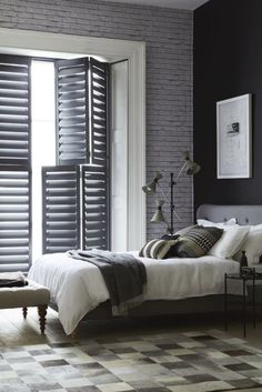 Grey/monochrome bedroom scheme: Taupes, greys and whites are the favourite colours at the moment, but brighter, more adventurous shades are also coming to the fore. The most popular style is the tier-on-tier panel shutter, on which the top and bottom tiers can open separately. They work especially well in homes that are overlooked from the street as the bottom panels can be kept closed for privacy while the louvres are opened to let in light. - California Shutters