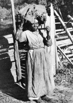 CHARITY STEWART was born in 1844. During the Civil War she was hidden in the swamps of Jefferson County to make soap for the soldiers. After freedom, she returned to her former owners home where she stayed until they died. For many years she lived alone in an old log house in Jefferson County, Florida. She was 93, when this photo was taken in 1937.