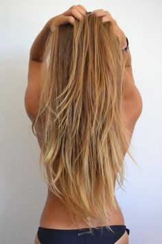 Honey blonde hair in long layers