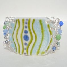 Ceramic focal and wire knit cuff from lapisbeach on Etsy. Ceramic focal courtesy of ginpins on Etsy.