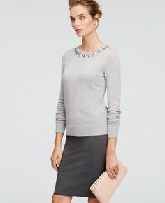 A brilliantly bejeweled neckline transforms this wardrobe staple into a modern gem. Embellished jewel neck. Long sleeves. Ribbed cuffs and hem.