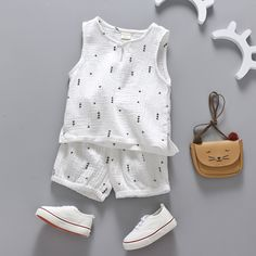 Keep them cool this summer in these star printed shorts and sleeveless top. Please allow weeks for shipping Baby Boy Fashion, Toddler Fashion, Fashion Kids, Boys Summer Outfits, Baby Boy Outfits, Kids Outfits, Baby Boy Dress, Little Girl Dresses, Baby Shirts