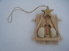 toothpick manger, mary & joseph lima beans, and a black-eyed pea for baby Jesus.