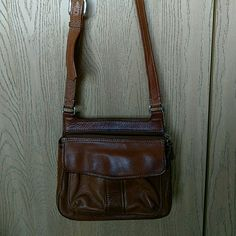 """Vintage Fossil Cross Body Bag Pebbled leather bag with double pockets in front and organizer in the back, a few darkened areas in the leather from age, strap is adjustable from 19"""" to 23"""" drop, 9"""" x 10"""" x 3"""" Fossil Bags Crossbody Bags"""