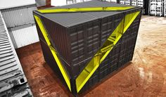 the black cubic volume comprised of six shipping containers offers a two-storey loft space that functions as both a gallery and education space.