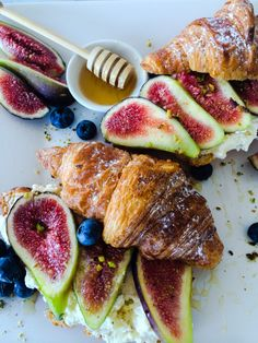 Croissants with fresh ricotta, figs, honey and crushed pistachios.