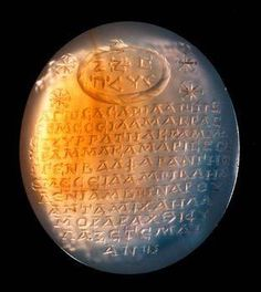 An ancient Roman chalcedony 'magical gem', second century, engraved with an ouroboros, symbol of eternity and an inscription. (Kunsthistorisches Museum Vienna)