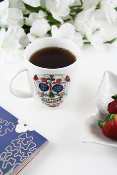 Getting the morning started with Your Tea Tiny Tea and a favorite day of the dead mug. Tiny Tea is all natural and helps boost your mood, energy and more!