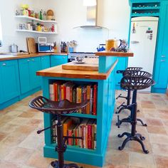 @parsekus on Instagram - our turquoise blue shaker style kitchen with open shelving and metro tiles, all set off with tractor seat bar stools! Tractor Seat Bar Stools, Shaker Style Kitchens, Metro Tiles, Concrete Floors, Open Shelving, Turquoise, Flooring, Interior Design, Table