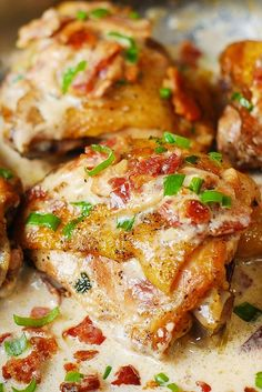 Pan-fried chicken thighs in a creamy bacon sauce with a touch of lemon! Quick and easy recipe for skin-on, bone-in chicken thighs. Click through for recipe!