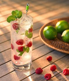 "raspberry mojito | 8 fresh mint leaves  1/2 ounce freshly squeezed lime juice  1 teaspoon superfine sugar  2 ounces white rum  2-3 ounces seltzer  4-6 fresh raspberries    Directions:    Place mint leaves, lime juice and sugar in a highball glass (something tall and narrow is perfect). Using the straight end of a wooden spoon, gently press on leaves to release flavor (""muddle"" is the official term).    Fill glass with ice cubes. Pour in rum. Top off with seltzer. Drop in raspberries, and…"