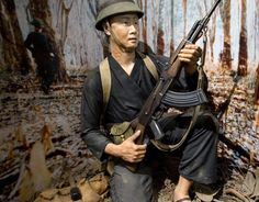 Compare a US soldier   and Vietcong soldier (pictured here) as they patrol their areas