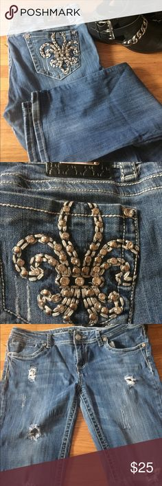 LA Idol fleur de lis bling pocket distress denim LA Idol fleur de lis bling pocket distress denim. Show signs of wear on the inside thigh area (see last pic) & a little at the hem but since they are a distressed denim to begin with it just adds to the look in my opinion but i priced them to reflect the wear. No bling missing that I see. LA Idol Jeans Boot Cut