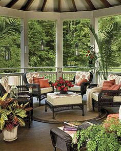 Enjoy your wooded backyard this Summer with a vaulted ceiling porch complete with wicker chairs and ottoman