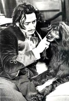 Salvador Dalí with his Afghan Hound during his stay in the United States, 1940-48.