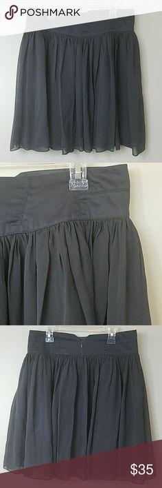 "Anthropologie Odille Gray Silk Overlay Skirt Anthropologie Odille Gray Silk Overlay Skirt.  Size 0.  Gorgeous flowy skirt!  Back zip, lined. Waistband is 100% cotton. Skirt is 100% silk. Lining is 100% acetate. 14.5"" across the waist.  20"" long. Anthropologie Skirts A-Line or Full"