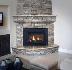 Are you lucky enough to have a living room with fireplace? A fireplace is an architectural structure designed to contain a fire. The idea of a corner fireplace living room is amazing. Fireplace Inserts, Fireplace Wall, Living Room With Fireplace, Fireplace Design, New Living Room, Fireplace Mantels, Fireplace Ideas, Fireplace Garden, Fireplace Furniture