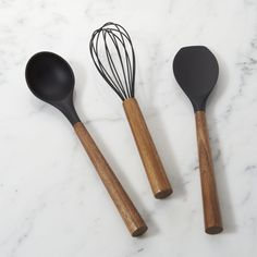 Shop Black Silicone Utensils with Acacia Wood Handles.  This beautiful marriage of matte black silicone and gorgeous acacia wood crafts stylish yet practical utensils for mixing, stirring and serving.