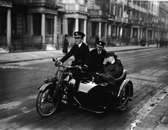 1920: Two female police officers escort a man home by sidecar. When his friends find out the next day, they laugh. | The 15 Best Moments In 20th Century Drunk History