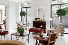 Designer David Easton and artist James Steinmeyer gave the living room of their modern Tulsa, Oklahoma, getaway a warm makeover with Venetian-plaster walls and crimson velvet slipper chairs. Architectural Digest, Interior Design Inspiration, Home Decor Inspiration, Design Ideas, Living Room Designs, Living Spaces, Living Rooms, Living Area, Architecture Design