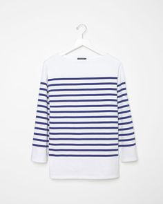 Striped shirt. See why it's a closet must-have and shop it and 29 other trend-resistant pieces every woman should have by the time she's 30.