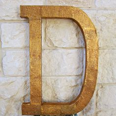 Make paper look like metal when you transform a monogram letter with embossed sheet metal. Create wall art as unique as you are!
