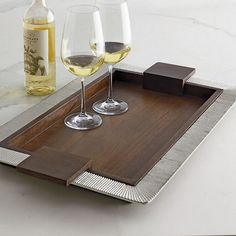 Mango Wood Serving Trays - These beautiful mango wood serving trays are the epitome of contemporary elegance – marvel at the interplay between the richly grained wood and decoratively designed aluminum trim. These rectangular wood serving trays are carefully carved from mango, a dense, durable hardwood that glows with warmth and captivates the eye with gorgeous graining of varying shades.