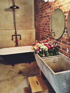 Clawfoot tub & brick wall - just like the bathroom in the home in which I grew up !