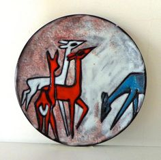 Ceramic tile plaque with white deer in red blue and white Ruscha Germany. Stylish appearance. Glossy glazed with relief structure. On the back: 117 74 60s.  Dimensions: Height: 3 cm. Diameter: 22 cm. Weight: 660 grams.