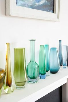 colored glass bottles -i put them in my window sills to let the natural light peer through them