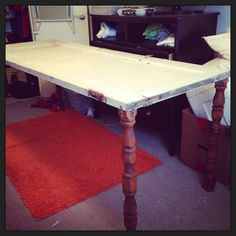 My personal desk I made from a salvaged door and legs from an old baby crib.
