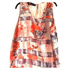 INC floral and snakeskin pattern tank top This INC top mixes floral print with a snakeskin pattern on a flowing tank top. Oranges, pinks, grays, and white make up the colors. Slightly sheer, but no cami needed. Throw a gray cardigan over it and go! INC International Concepts Tops Tank Tops