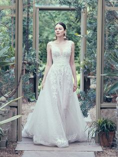 An A-line wedding gown is the bread-and-butter of bridalwear, but you'd hardly recognize it in this uniquely layered, ultra lacy, fabulously floral number here.