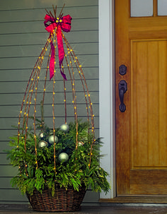 Rustic Willow Obelisk makes a great display. Christmas Topiary, Christmas Planters, Indoor Christmas Decorations, Christmas Porch, Outdoor Christmas, Xmas Tree, Christmas Crafts, Christmas Ornaments, Tomato Cage Crafts