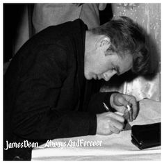 James Dean signing autographs during Sweethearts Ball at his old High School in Fairmount Indiana, ...