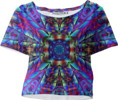 """""""CELESTIAL CENTER"""" CROP TEE   BY DOVETAIL DESIGNS.  """"Celestial Center"""" is an explosion of color and pattern, sure to add vibrance to your day!! This pattern was created by collaging layers of photos, including a detail from a nautilus shell, a tiled, pool house rooftop in Washington, D. C. and landscape photos."""