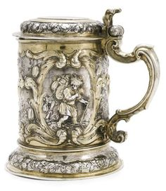 A German parcel-gilt silver tankard, Hans Polmann, Danzig, circa 1660. Embossed and chased with cherubs symbolizing Autumn, carrying nature's bounty andincluding signs of Libra, Scorpio and Sagittarius, marked on body and cover; 20.5cm, 8in high; 890gr, 28oz 12dwt