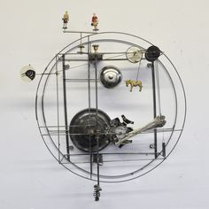 "Gina Kamentsky creates kinetic sculptures which exist in the somewhat chaotic and messy real world and animated films for the screen where gravity is a bit less of a concern.  ""For the past two decades I've created ""Mechanical Confections"", one of a kind automata and kinetic sculpture incorporating found objects, metal and electro-mechanical components."